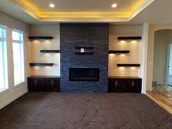 A beautiful stone fireplace and entertainment center designed and built by Bachmeier Custom Homes